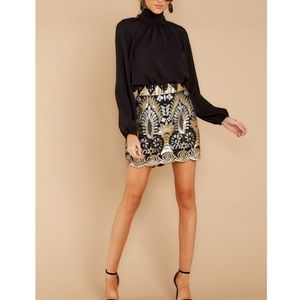Into the light gold and black sequin skirt